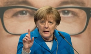 Angela Merkel speaks at a election campaign in front of a poster of the top candidate of Merkel's Christian Democrats in Baden-Wuerttemberg state, Guido Wolf in Nuertingen, southern Germany.