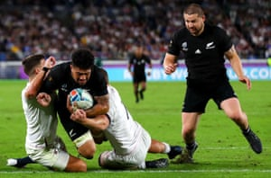 New Zealand's Ardie Savea scores a try despite the efforts of England's Ben Youngs and Sam Underhill.