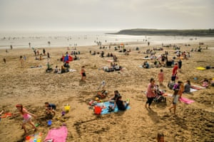 Barry Island, UKPeople flock to the beach in Wales during a very warm March day