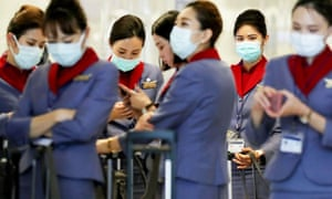 A China Airlines flight crew wear masks at Los Angeles international airport.