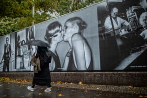 Berlin, Germany A woman passes the outdoor exhibition Helmut Newton One Hunded at Kraftwerk Mitte in Berlin