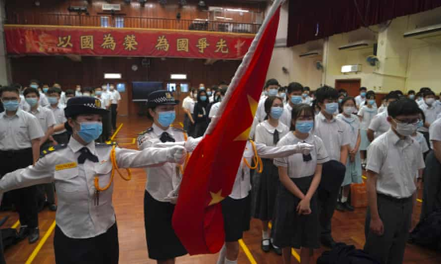 Students attend a flag-raising ceremony at a secondary school in Hong Kong to mark National Security Education day