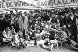 Reims' players celebrate with trophy after their 3-1 victory over Nimes in the 1958 French Cup final.