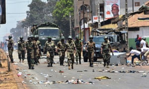 Protesters confront the army in the streets of Conakry on 22 March, the day of Guinea's constitutional referendum