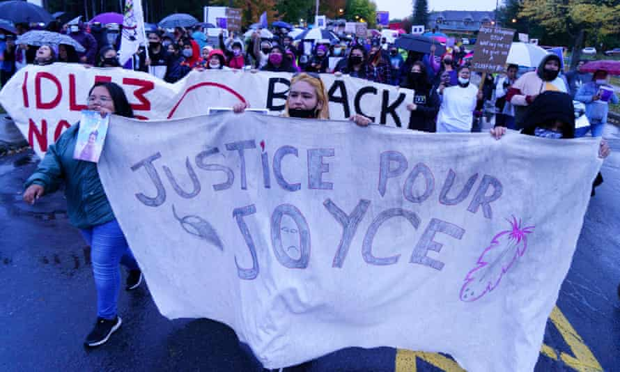 People attend a vigil in front of the hospital where Joyce Echaquan died in Joliette, Quebec, on 29 September.