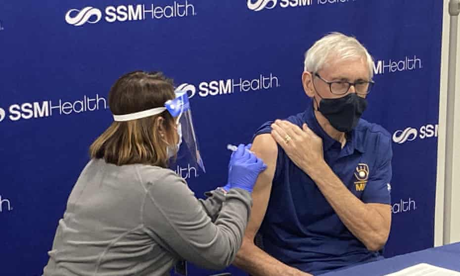Governor Tony Evers receives the coronavirus vaccine on March 1 from Bobby Rogers, a nurse registered in Madison, Wisconsin.  Vaccine hesitation seems strong where distrust of government agencies is greatest.