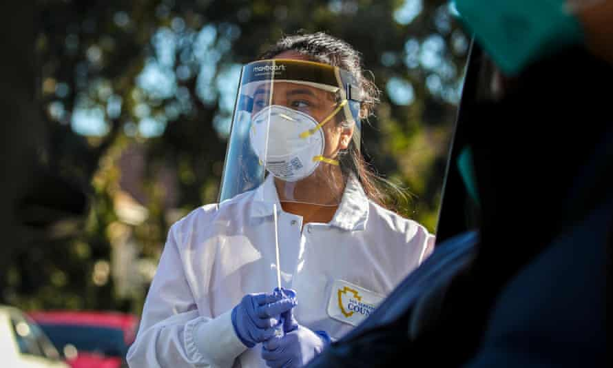 Marijorie Tabago, a nurse with the San Bernardino county public health department, collects samples for Covid testing.