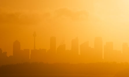 Sydney skyline silhouetted against the setting sun on a hot summers day