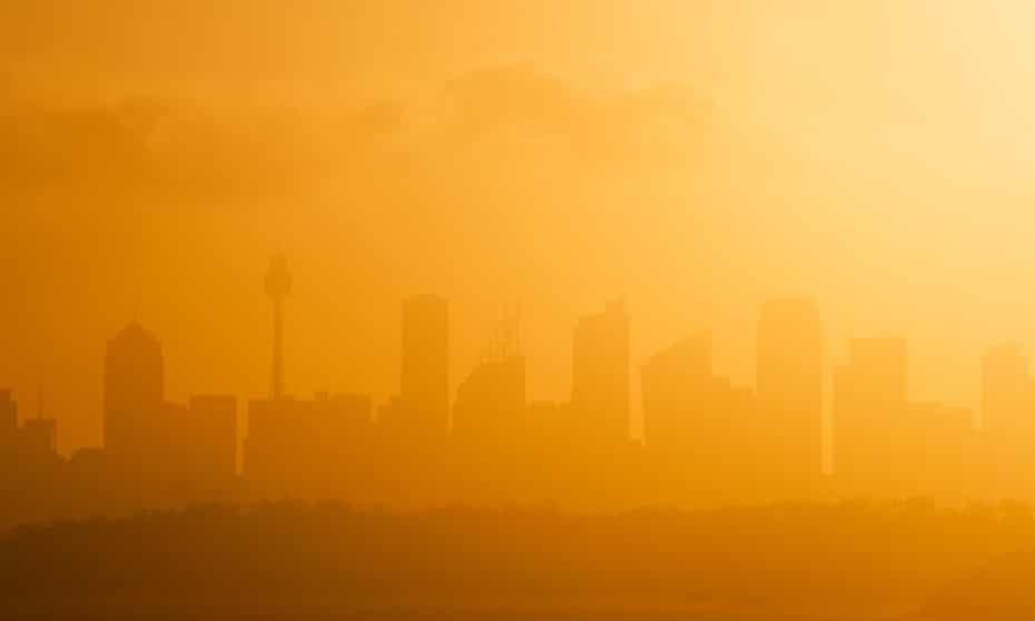 Sydney's skyline silhouetted against the setting sun on a hot summer day