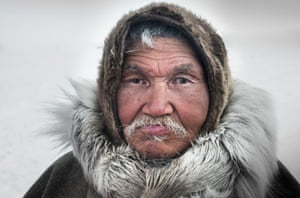 A reindeer herder looks on at a nomad camp at 150 km from the town of Salekhard