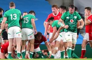 Ireland's Peter O'Mahony celebrates Quinn Roux's try.