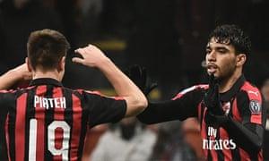 Lucas Paquetá celebrates with Milan teammate Krzysztof Piatek.