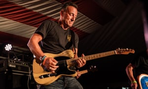 Bruce Springsteen playing at the opening of the Springsteen: His Hometown exhibition