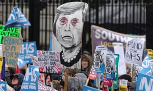 Protesters hold a placard of Theresa May during a march last weekend calling for an end to the NHS crisis.