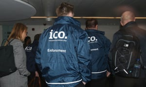 Enforcement officers working for the Information Commissioner's Office entering the premises of Cambridge Analytica.