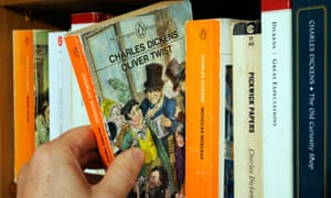 Familiar selection … a hand taking a Charles Dickens novel from a bookshelf.