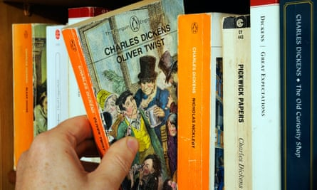 Picking a pocket book ... a hand removing a copy of Oliver Twist from its shelf.