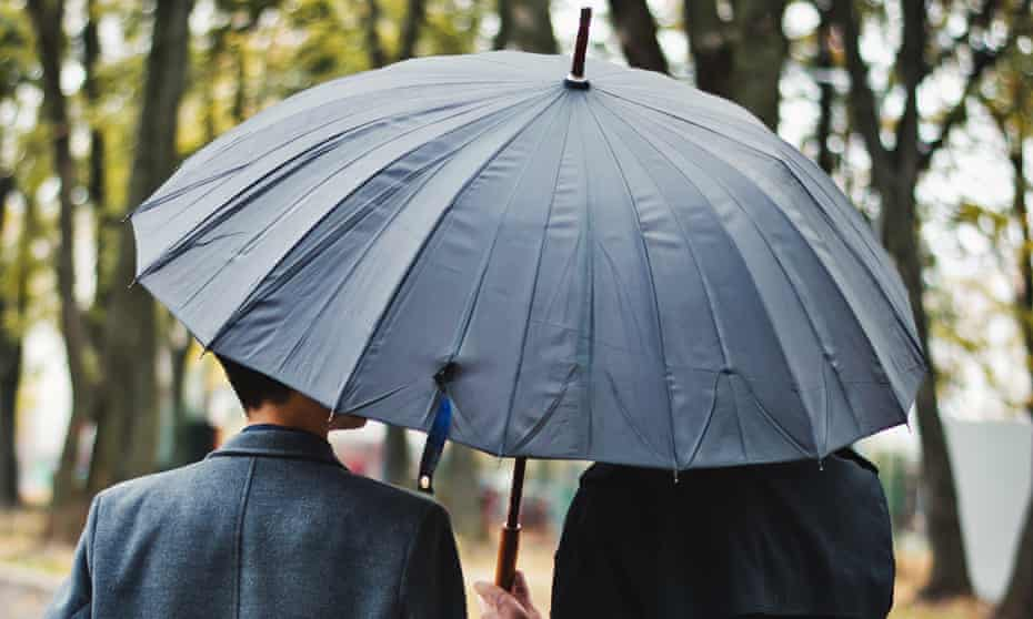 couple in park with umbrella