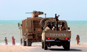 Yemeni government forces parked on the eastern outskirts of Hodeidah.
