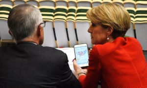 The minister for foreign affairs, Julie Bishop, shows the Australian prime minister, Malcolm Turnbull, her phone with information of the US election during question time on Wednesday