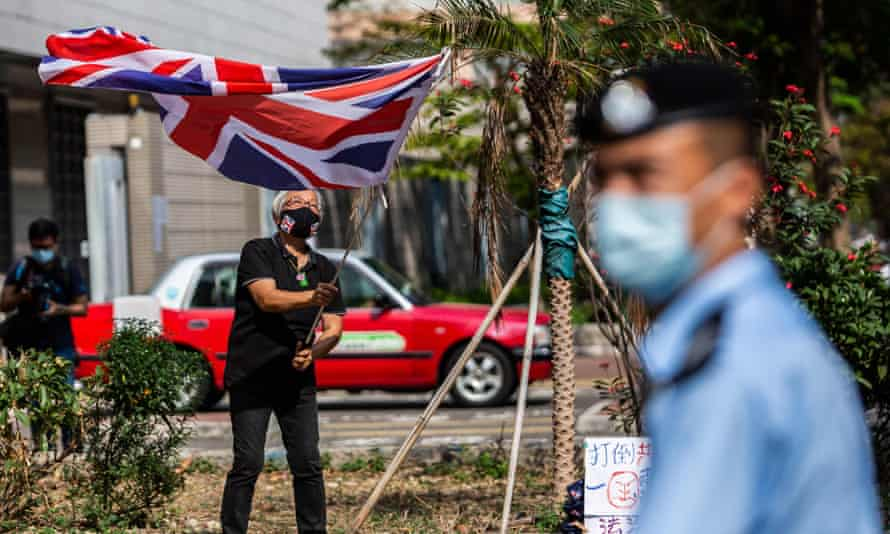 Alexandra Wong waves a British union jack flag outside West Kowloon court in Hong Kong on 1 April
