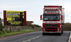 Traffic passes a post-Brexit, anti-border poster on the Dublin Road between Newry in Northern Ireland and Dundalk in the Irish Republic.