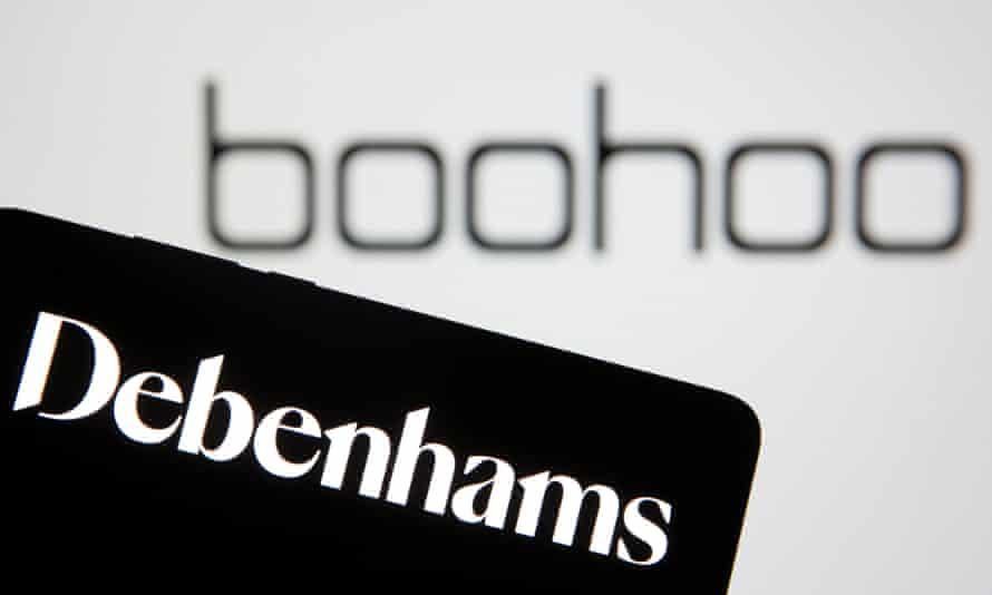 Debenhams logo is seen on smartphone in front of a displayed Boohoo logo.