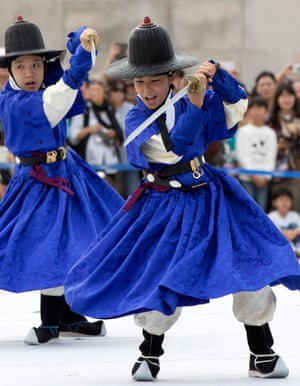 Seoul, South Korea. Children demonstrate martial arts during a ceremony at Gyeongbokgung Palace