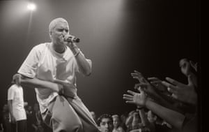 """Eminem on stage. 'The first time I rapped in front of actual people that mattered, in a club, I got booed,' he recalled. 'It was very traumatic for me, I just remember it being so fucking traumatic, and I think I went home and I was like, """"Man, I quit."""" And a week later, a day later, an hour later, I got the urge, and I was like, I gotta get up- I gotta do it again."""""""