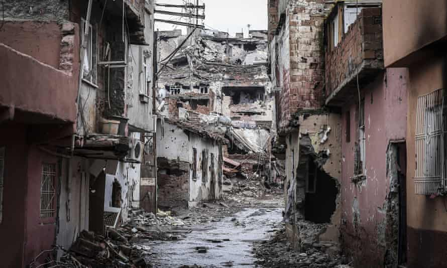 Roads and buildings, blocked and damaged by PKK terrorists, are seen as Turkish Security Forces carry out a counter -