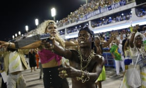 The Beija-Flor samba school perform a violent gangland scene in the Sambadrome, Rio de Janeiro.