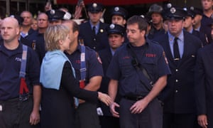 Hillary Clinton greets New York City firefighters at the funeral for department chaplain the Rev Mychal Judge, who died at the World Trade Center.
