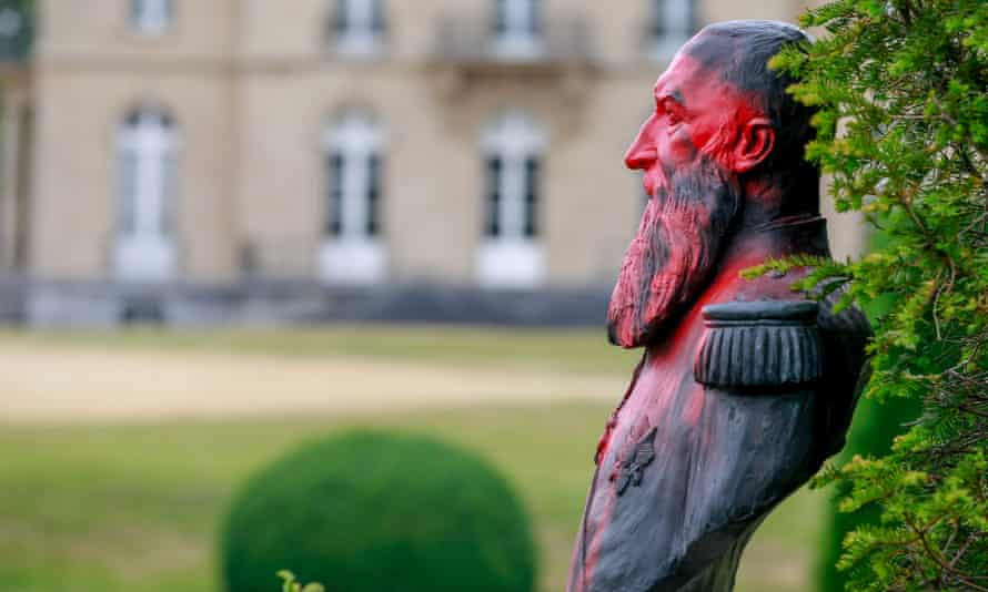 A defaced statue of Leopold II at the park of the Africa Museum, in Tervuren, near Brussels