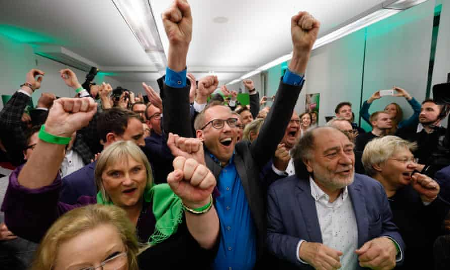 Supporters of the Greens party react to exit polls in Wiesbaden, Germany