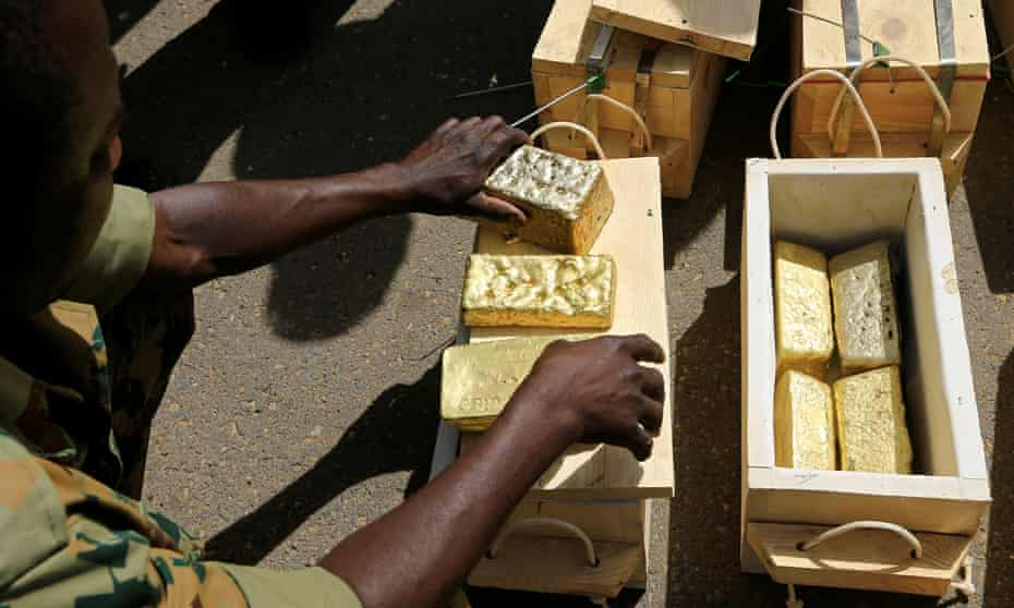 Sudanese Rapid Support Forces display gold bars seized from a plane that landed at Khartoum airport as part of an investigation into possible smuggling