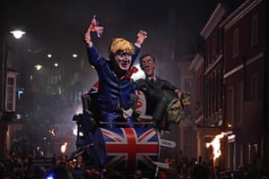 Effigies of Boris Johnson and Jacob Rees-Mogg are paraded through the streets