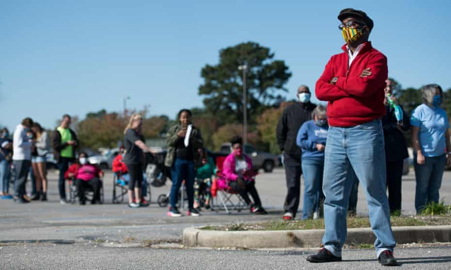 Voters wait in line to cast ballots in Effingham, South Carolina. The US experienced a historic turnout rate of 65.1% – the highest in over 100 years.