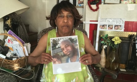 Ada Perkins-Henderson holds a photo of her son, Richard Perkins, who was killed by Oakland police last year.