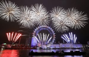 Fireworks explode over the London Eye on New Years Day 2019.