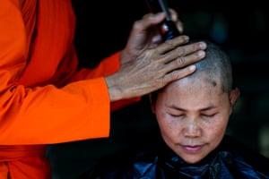 A devotee has her hair cut