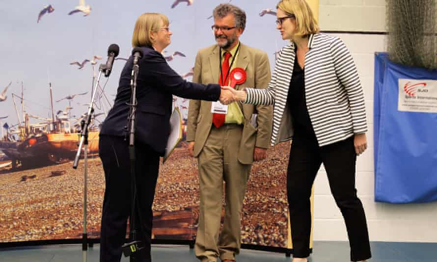 Britain's Home Secretary Amber Rudd's shakes hands with the returning officer.