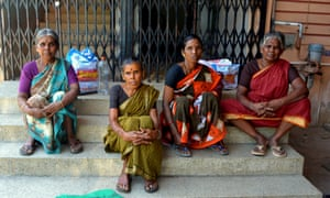 Mothers waiting for daughters to have sterilisation surgery at a family planning clinic in Ellis Nagar, in the south Indian city of Madurai.