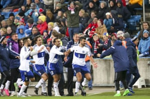 Huge celebrations are about to get underway on the San Marino dugout after Mattia Stefanelli, right, scored their first away goal in 15 years.