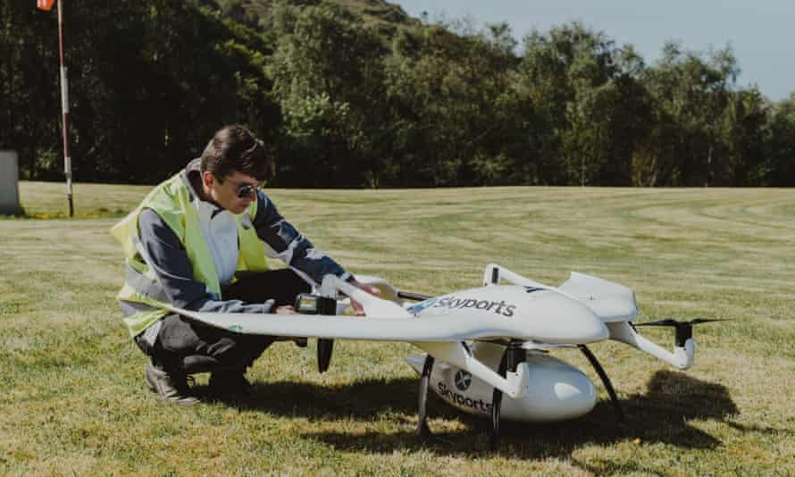 A Skyports worker with a delivery drone on the Isle of Mull.