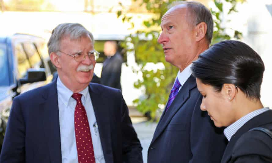 John Bolton with Nikolai Patrushev, head of Russia's security council, in Moscow on 22 October.