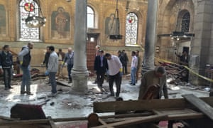 Egyptian security forces examine the scene inside St Mark's Cathedral following Sunday's bombing