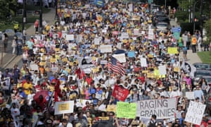Demonstrators marched through the streets of Winston-Salem, North Carolina, last year after the beginning of a federal voting rights trial challenging the 2013 state law.