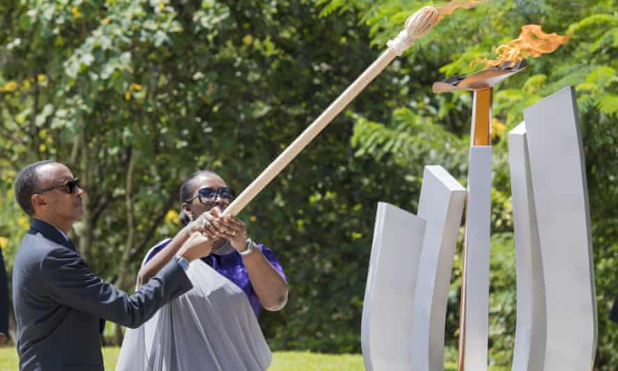 Rwanda's president, Paul Kagame, and first lady, Jeannette Kagame, light the flame of remembrance at Kigali Genocide Memorial