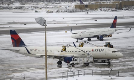 A crew works to deice a plane at Minneapolis-St Paul international airport.