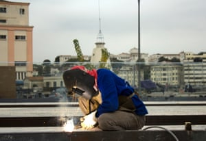 Will Rio be ready? A welder in Praca XV works to ready the City's famous square for the Olympic visitors